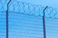 Fence with barbed wire Royalty Free Stock Image