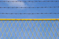 Fence and barbed wire Royalty Free Stock Photo