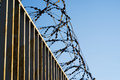 Fence with barbed wire. focus with shallow depth of field. Royalty Free Stock Photo