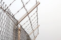 Fence with a barbed wire for protect Royalty Free Stock Photo