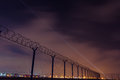 Fence with barbed wire, restricted area and starting plane Royalty Free Stock Photo