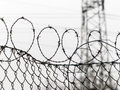 Fence with barbed wire a is secured symbolic photo for security prison and crime Royalty Free Stock Photo