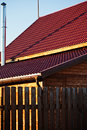 Fence chimney red tile of new wooden house wood in country village Royalty Free Stock Photo