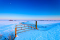 Fence on a grassland in winter Royalty Free Stock Photo
