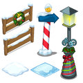 Fence, lamp, street sign decorated for Christmas