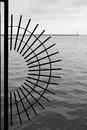 Fence and lighthouse abstract black white shot of a circular with a in the background chicago illinois Stock Photography