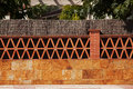 Fence made ​​of brick and stone around the home Stock Photos