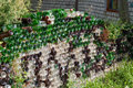 A fence made of empty glass bottles Royalty Free Stock Photo