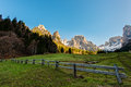 Fence in meadow in the Dolomites Royalty Free Stock Photo