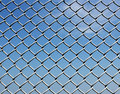 Fence of metallic net Stock Photo