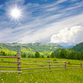 Fence in mountains meadow Royalty Free Stock Photo