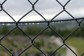 Fence after rain metal in a cloudy day Royalty Free Stock Photo