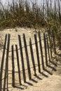 Fence on sand dune Royalty Free Stock Photo