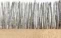 Fence on sand isolated Royalty Free Stock Photo
