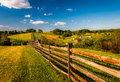 Fence and view of rolling hills and farmland in antietam national battlefield maryland horizontal Stock Photos