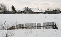 Fence at the village in a snow covered field winter russia Royalty Free Stock Photography