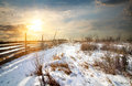 Fence in winter field Royalty Free Stock Photo
