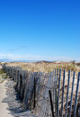 Fenced in the beach a cape cod fencing off sand dunes Stock Photo