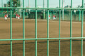 Fences at Baseball Field at  Schoolyard for practice. Royalty Free Stock Photo