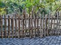 Fencing with dry wood logs Royalty Free Stock Photo