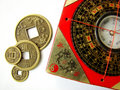 Feng shui compass and coins Royalty Free Stock Photo