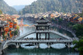 Fenghuang ancient town tuojiang river stone bridge and wooden houses many tourists visiting at hunan province china oct Stock Photography