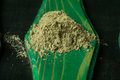 Fennel powder on a piece of green wood Royalty Free Stock Photos