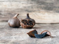 Fermented black garlic bulbs and cloves Royalty Free Stock Photo