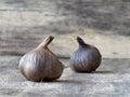 Fermented black garlic bulbs Royalty Free Stock Photo