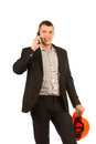 Fermez vous vers le haut de l ingénieur talking through phone de moyen âge Image stock