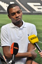 Fernandinho with microphones the vice captain of shakhtar met the media on the sidelines of the donbass arena pitch before the Royalty Free Stock Photos