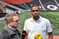 Fernandinho with translator the vice captain of shakhtar met the media on the sidelines of the donbass arena pitch before the game Royalty Free Stock Image