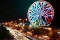 Ferris wheel and blurry night traffic lights Royalty Free Stock Photo