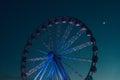 Ferris wheel against dark evening sky Royalty Free Stock Photo