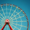Ferris wheel attraction on blue sky background Stock Photo