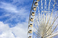 Ferris wheel with blue sky and cloud background Stock Image