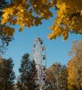 ferris wheel blue sky sunlight day autumn yellow leaves Royalty Free Stock Photo