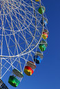 Ferris wheel brightly coloured gondola cabins of the at luna park sydney Stock Images