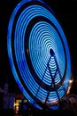 Ferris Wheel Electric Blue Color at Night Stock Photos