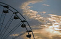 Ferris wheel a with a magestic sunset in the background Royalty Free Stock Photo