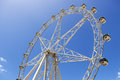 Ferris wheel observation or against brilliant blue sky Royalty Free Stock Photography