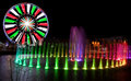 Ferris wheel in pigeon forge tennessee during the christmas holidays taken at night with long exposure with colorful water Royalty Free Stock Photos