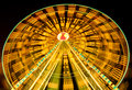 Ferris wheel spinning at fairground at night Royalty Free Stock Photo