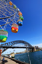 Ferris wheel and sydney harbour bridge australia october brightly coloured carnival the iconic the city of on a Stock Photos