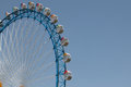 Ferriswheel with blue sky in front of on a sunny day Royalty Free Stock Photo