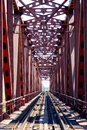 Ferrous prospect there is a of railway bridge span on a picture a bridge is made out of metal on him rails are laid Stock Photo