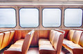 Ferry boat cabin and rows of seats looking out the window Stock Photography