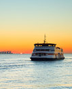 Ferry boat at sunset, Portugal Royalty Free Stock Photo