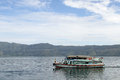 Ferry boat traditional on the lake samosir in indonesia Stock Image