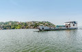 Ferry with cars and people passing by Mwanza on Lake Victoria,